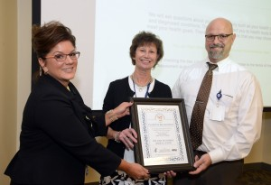 Caption (l-r):  Shanon Abbott, RN, BSN, Hospital Services Manager, New Jersey Sharing Network, presents the U.S. Department of Health and Human Services' HRSA award to Lourdes' Loretta Aigner, Director, Transplant program, and Bill Pierce, RN, BSN, CCRN, RRT, MBA/HCM, Patient Safety Officer and Director of Infection Prevention, Clinical Risk Management, and Nursing Quality. Lourdes is among a select group of hospitals nationwide recognized for raising organ and tissue donation awareness.